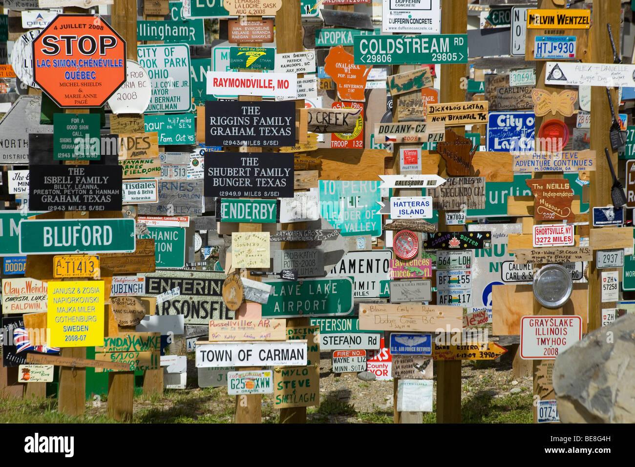 Famous Alaska Highway Sign Post Forrest in Watson Lake, Yukon Territory, Canada - Stock Image