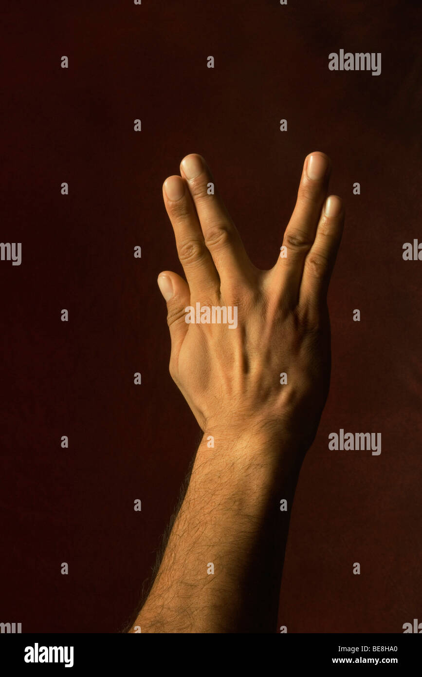 Hand making greeting gesture - Stock Image
