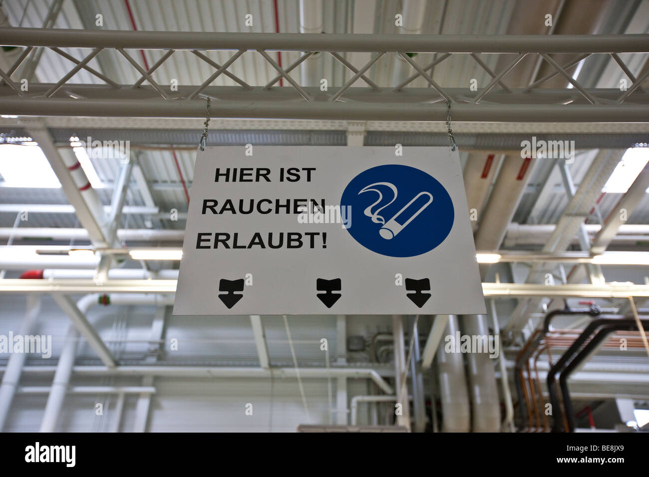 Smoking allowed here, sign, Aston Martin engine plant in Cologne, Rhineland-Palatinate, Germany, Europe - Stock Image