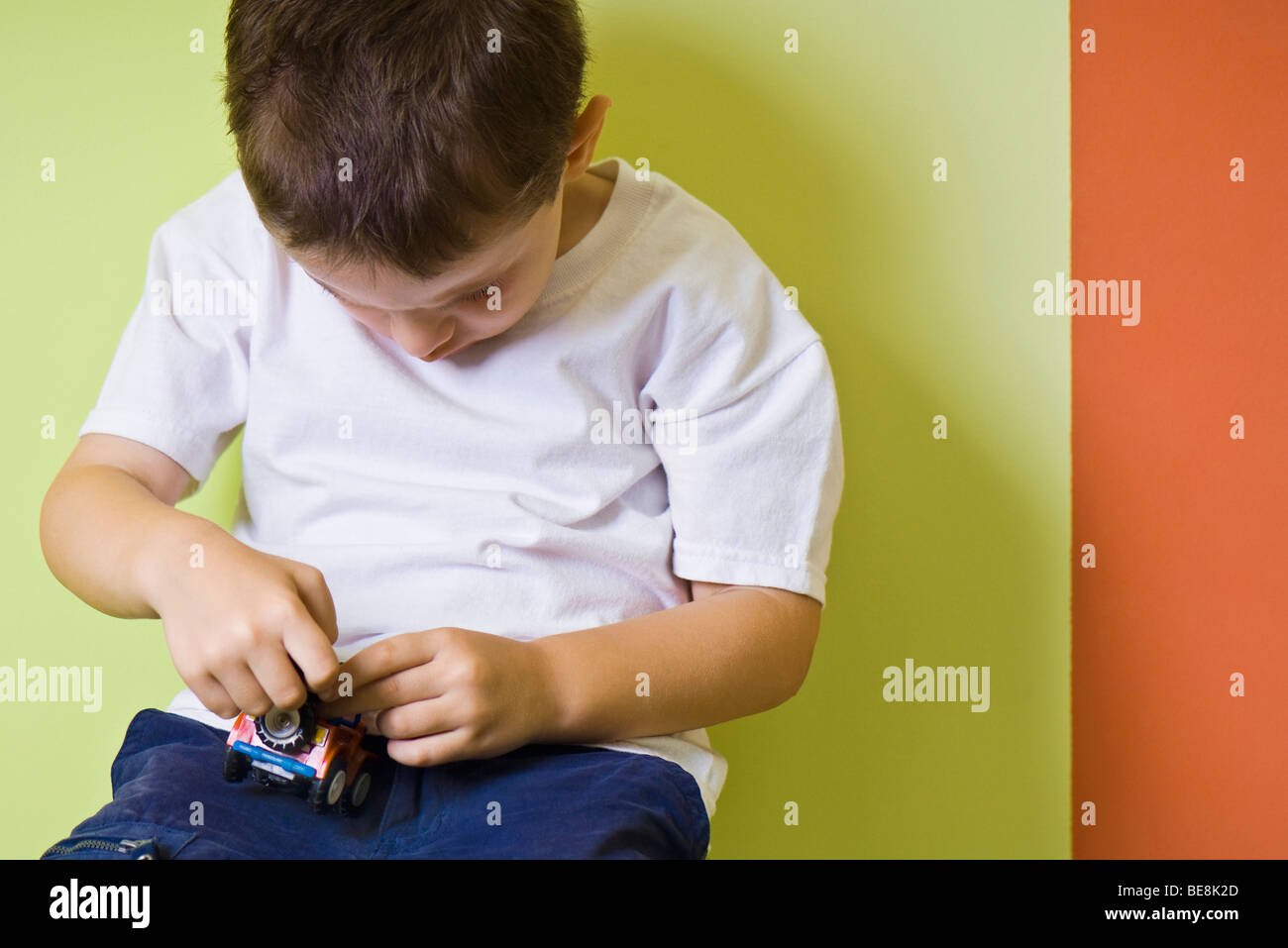 Little boy playing with toy car Stock Photo