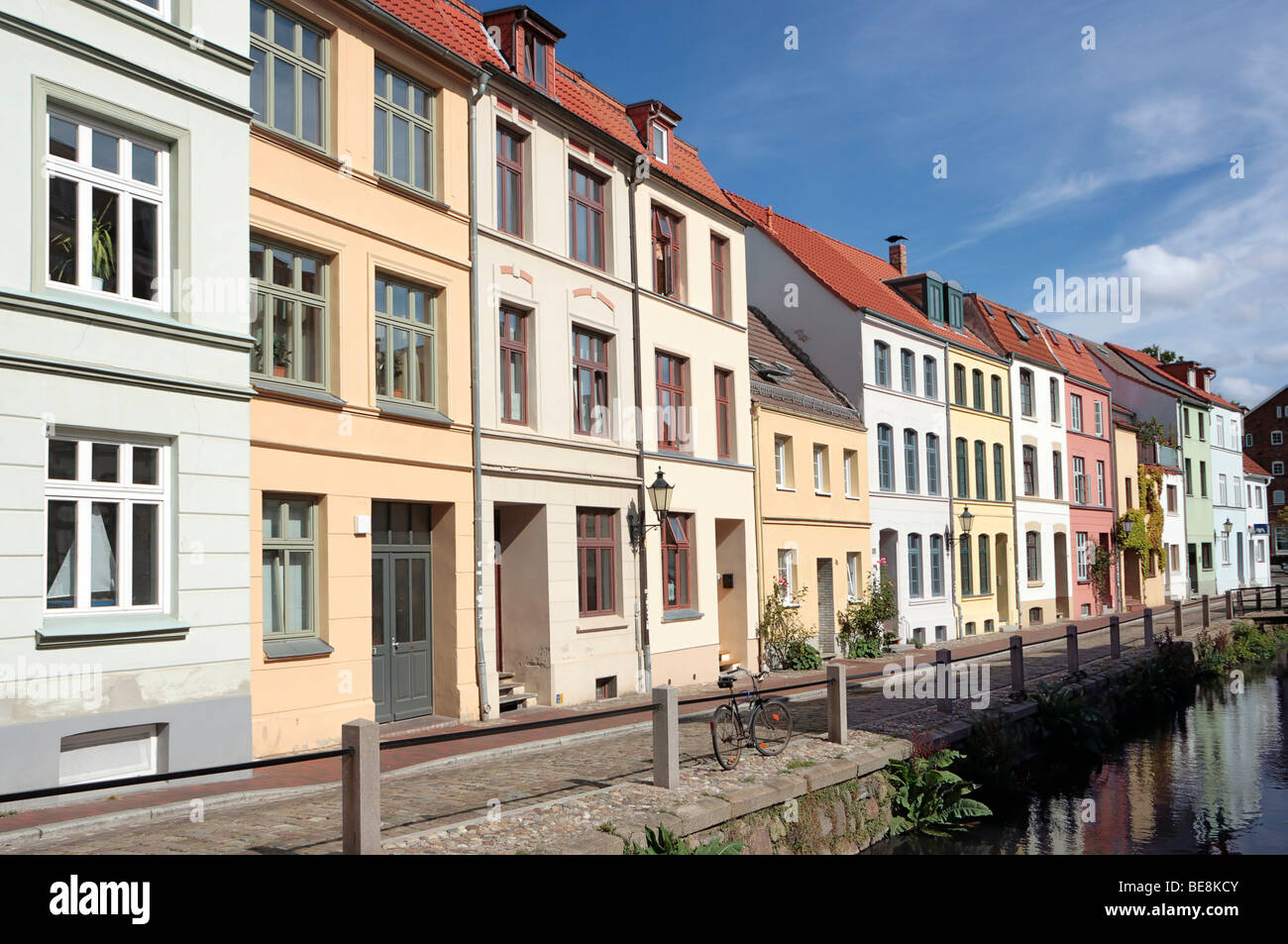 Historic row of buildings alongside the Frische Grube canal in the Hanseatic city of Wismar, UNESCO World Heritage - Stock Image