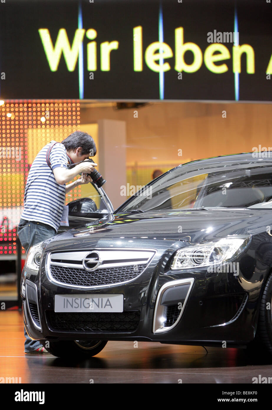 Visitor taking pictures of the new Opel Insignia at the 63. IAA Motor Show in Frankfurt/Germany - Stock Image