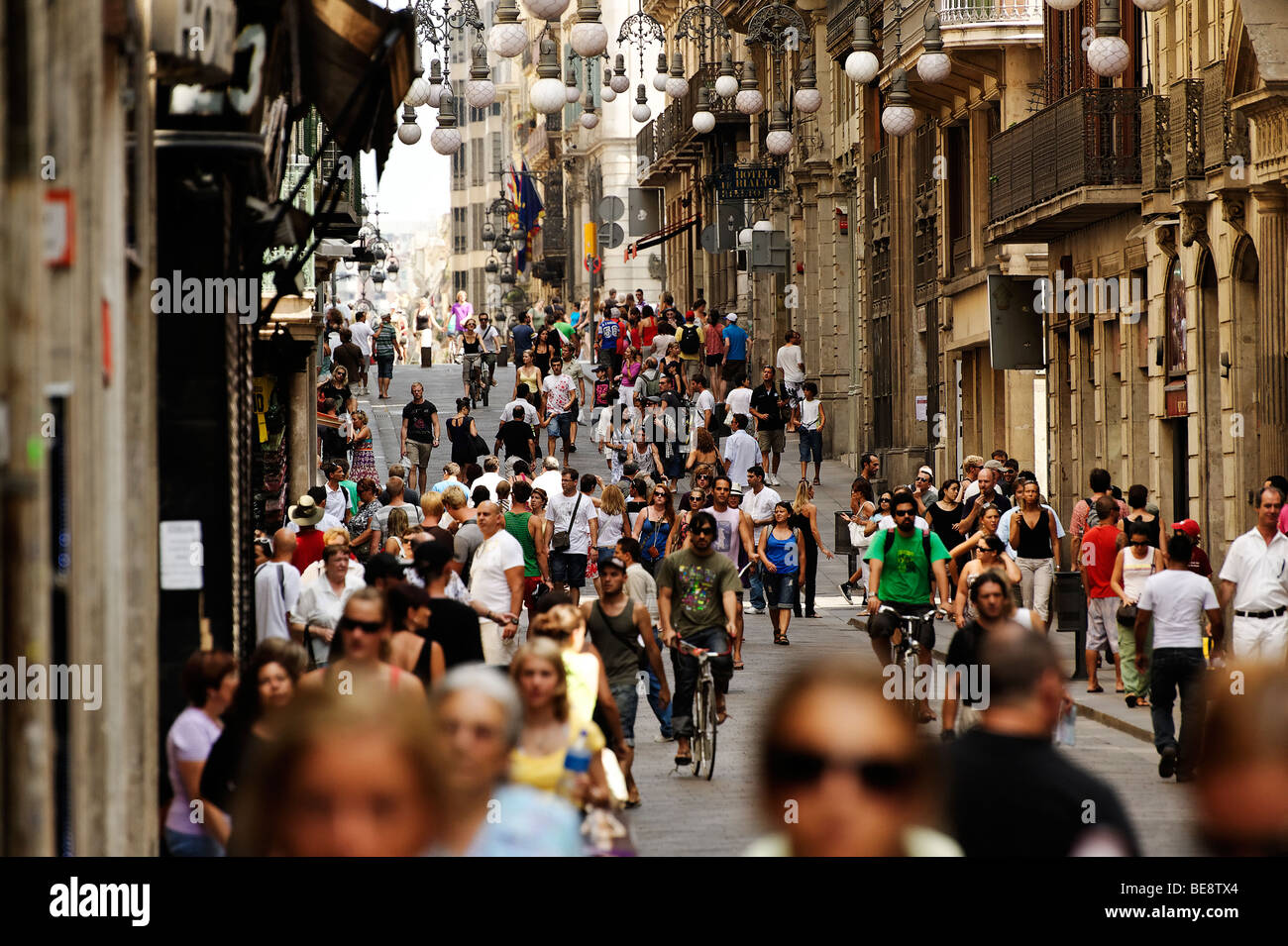 Busy shopping street Carrer de Ferran in Barri Gotic. Barcelona. Spain - Stock Image