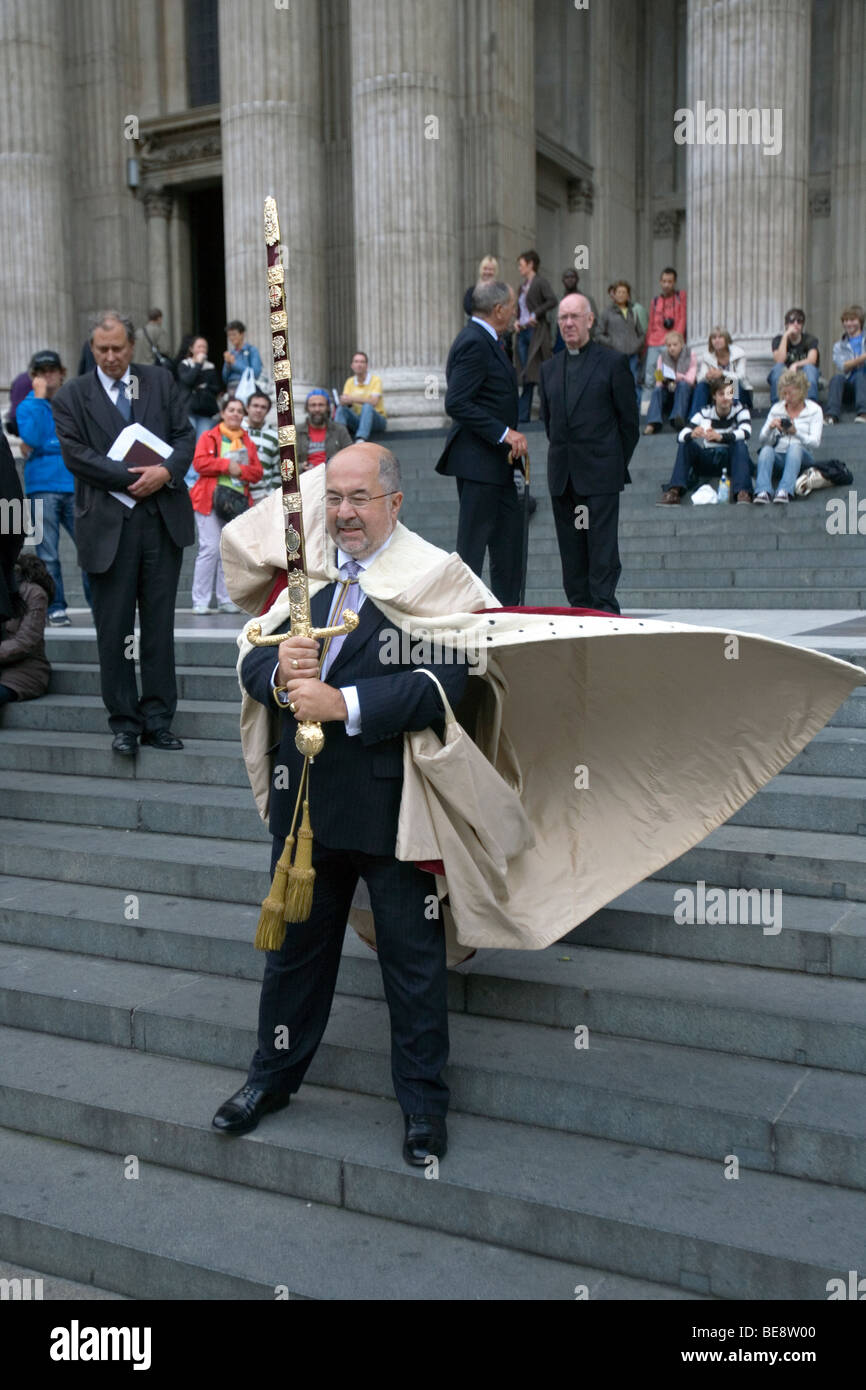 the lord mayor of london with ceremonial sword outside st pauls cathedral in london - Stock Image