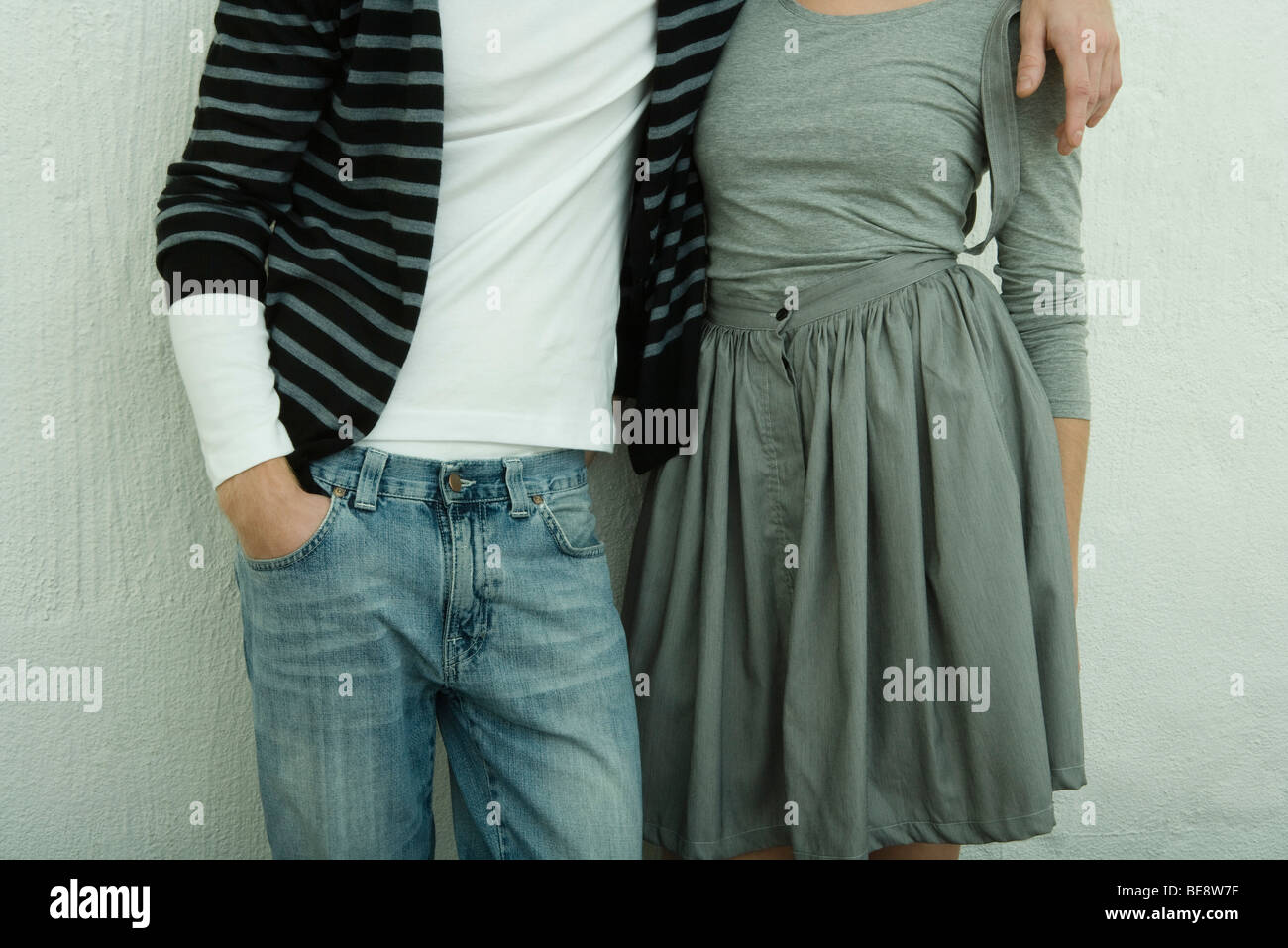 Casually dressed young couple, mid section - Stock Image