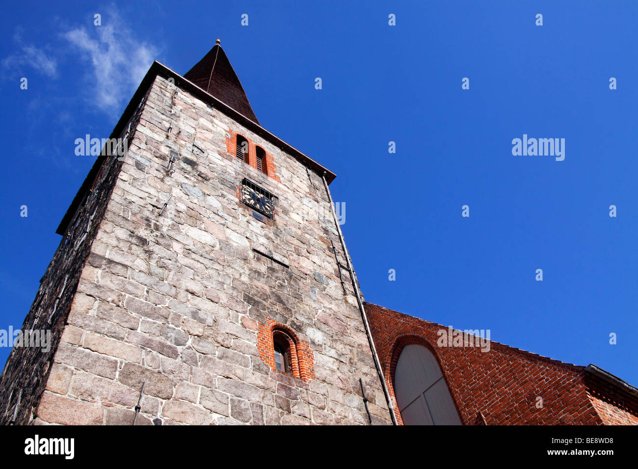 Spire of the gothic St. Johanniskirche church in Petersdorf, Fehmarn island, Ostholstein district, Schleswig-Holstein, - Stock Image