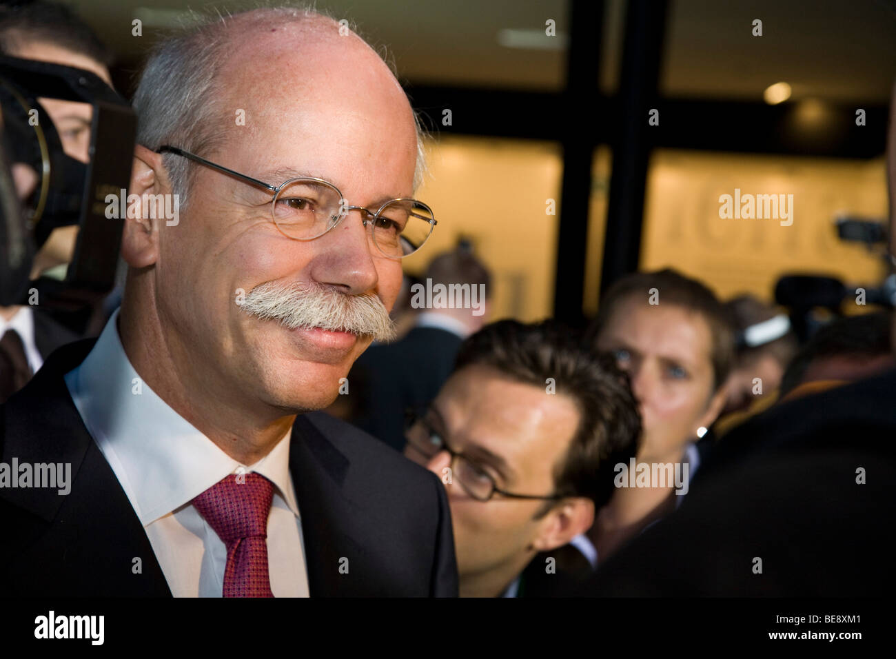 Dr Dieter Zetsche CEO of DaimlerChrysler talks at the Mercedes press launch at a European motor show - Stock Image