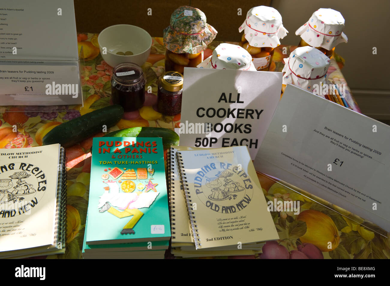 Pudding recipe and other cookery books for sale at Ludlow Methodist Church during Ludlow Food Festival Shropshire - Stock Image