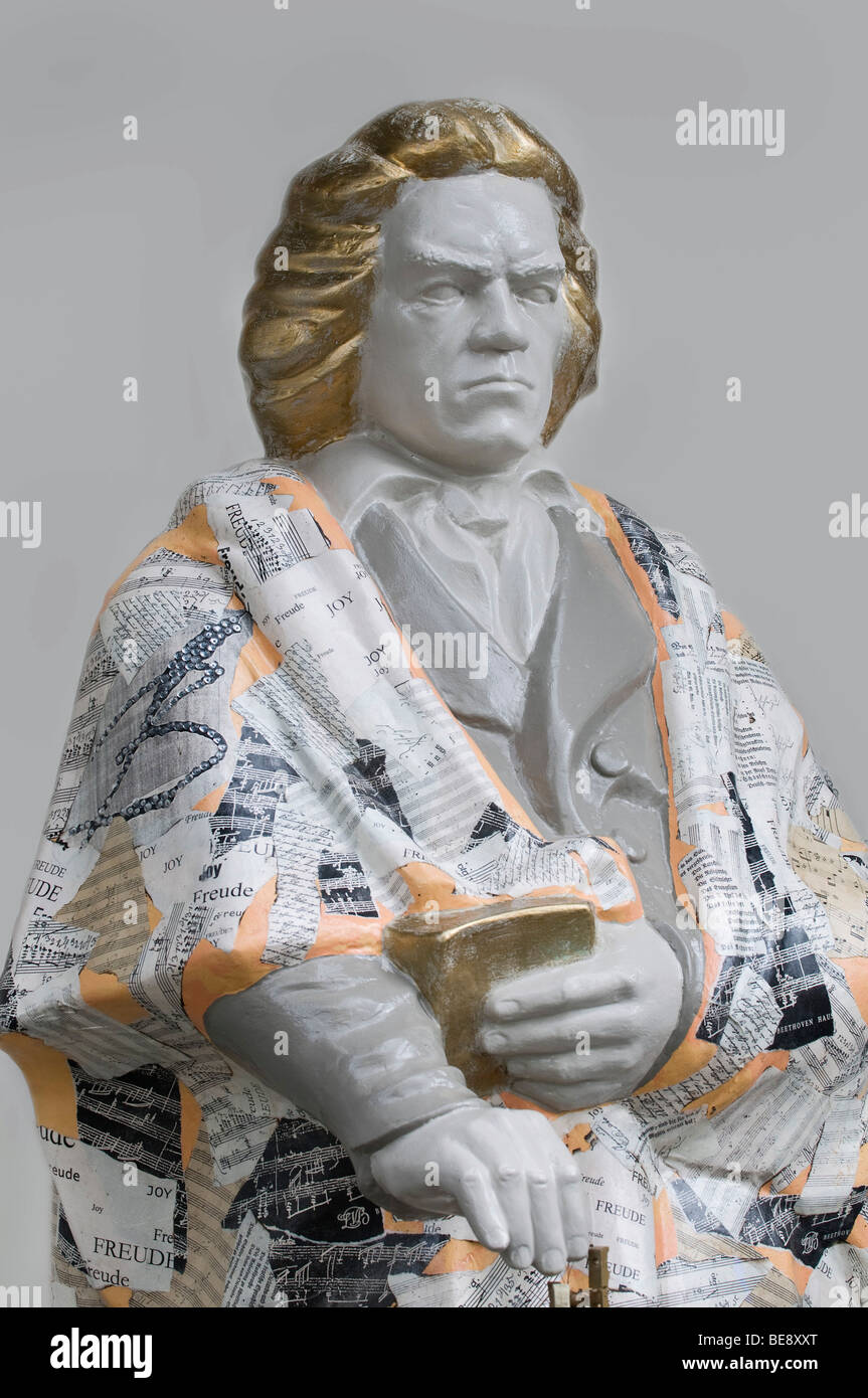 Statue of Beethoven, with Beethoven's lyric 'joy' and score parts - Stock Image