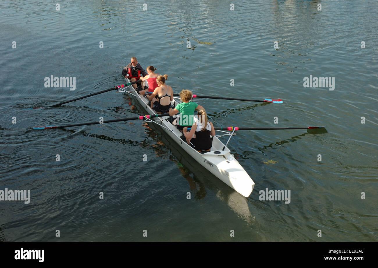 rowing boat and crew, Lymington harbour, Hampshire, England, UK - Stock Image
