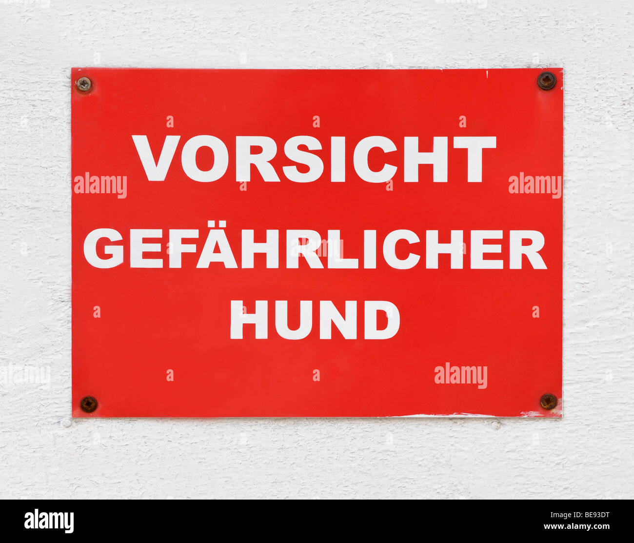 Red sign, Vorsicht gefaehrlicher Hund, German for Beware of dangerous dog - Stock Image