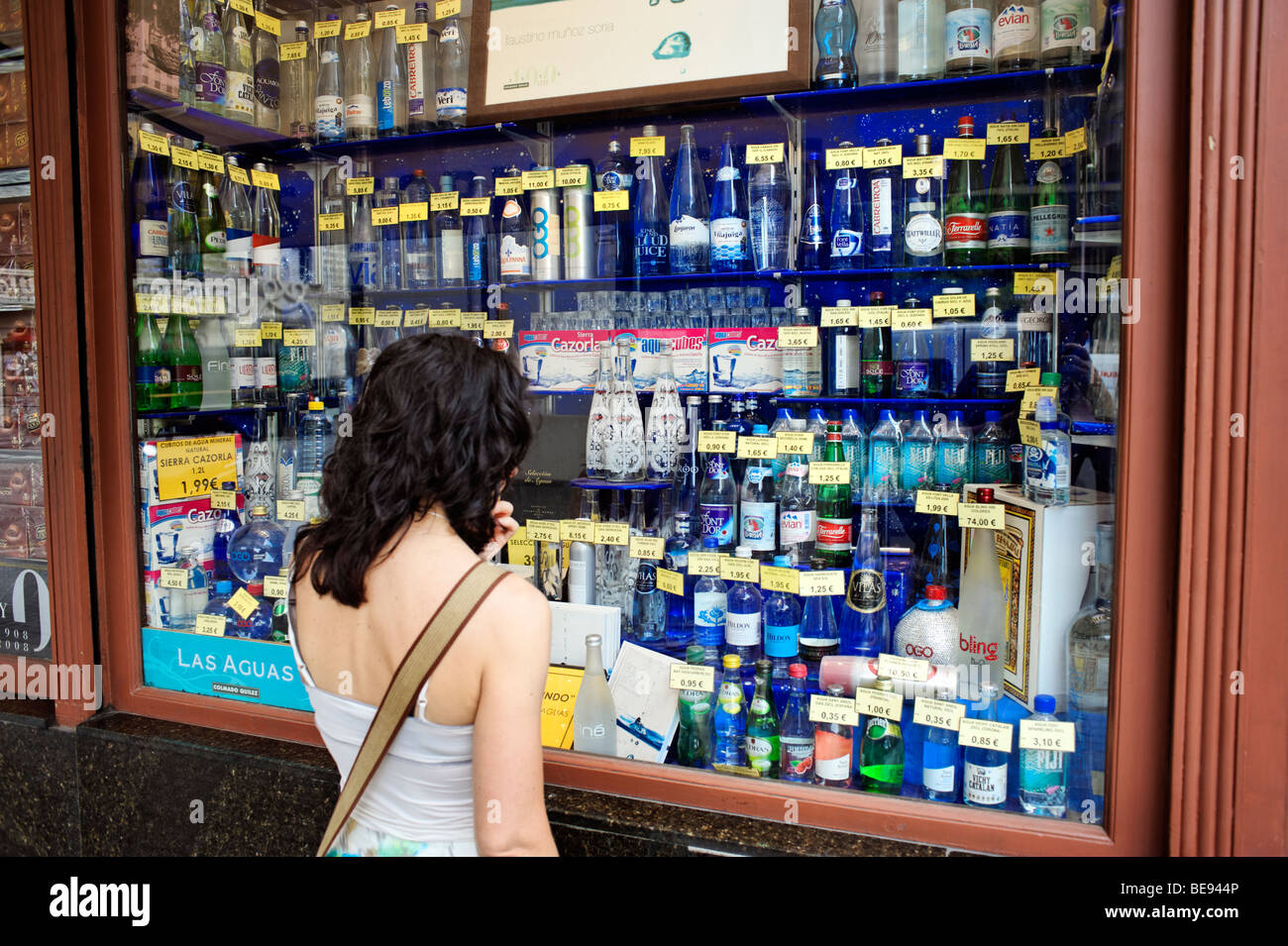 Shop window with huge selection of bottled mineral water. Barcelona. Spain - Stock Image