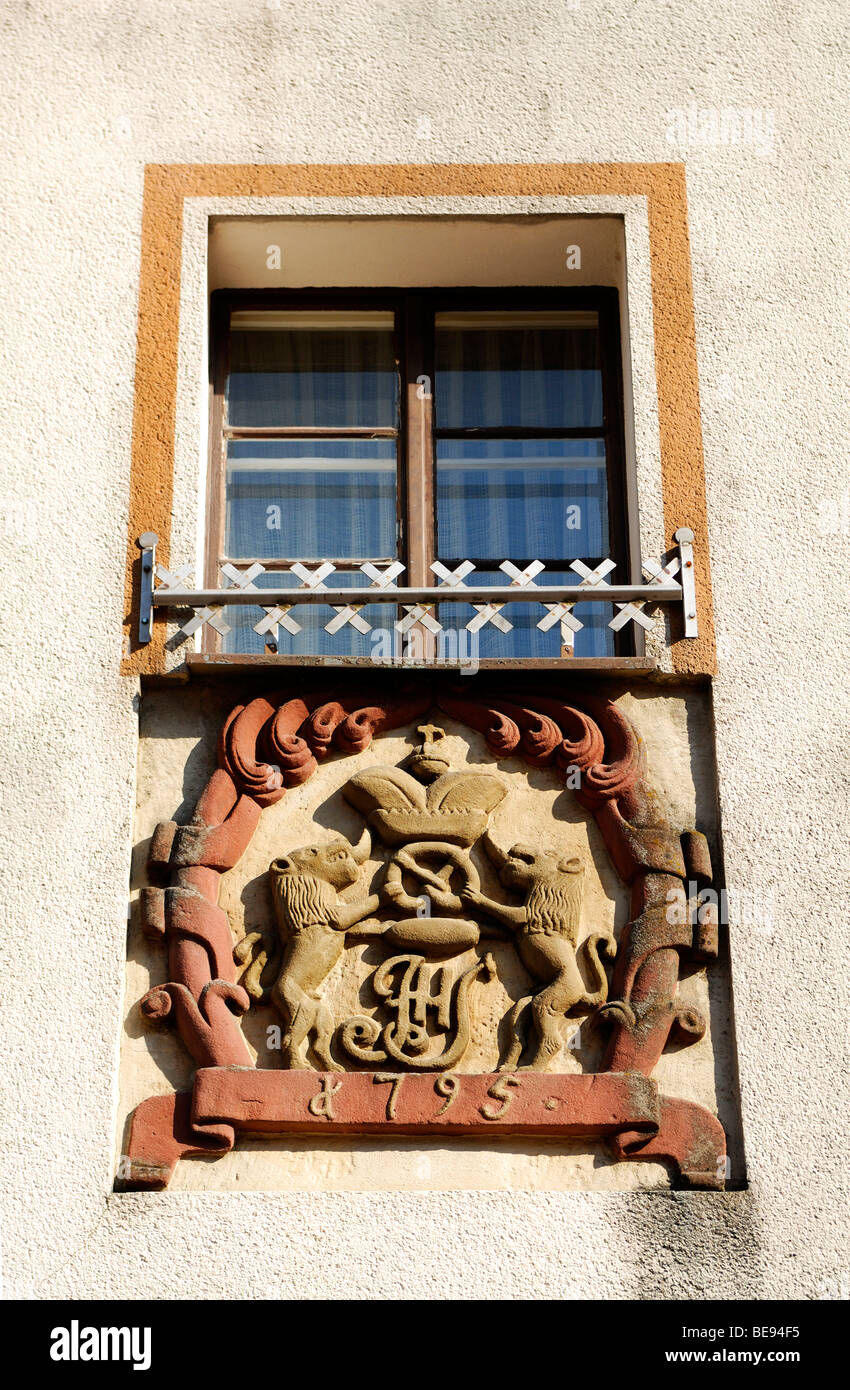 Old bakers guild sign under a window, Betzenstein, Upper Franconia, Bavaria, Germany, Europe - Stock Image