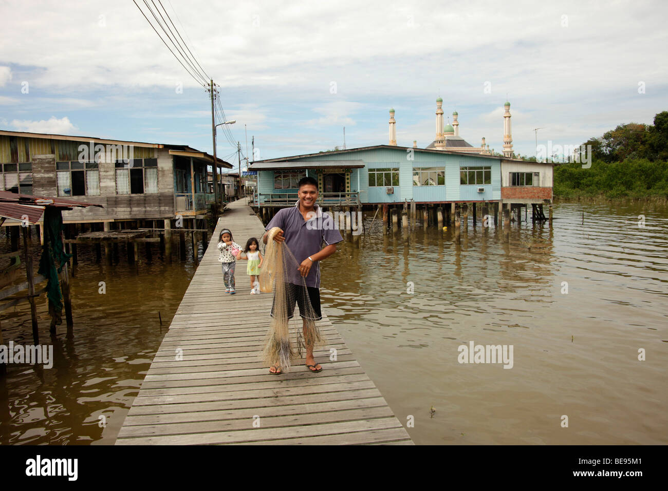 Fishermen in a village built on stilts, Kampong Ayer, Water Village, a district of the capital city, Bandar Seri - Stock Image