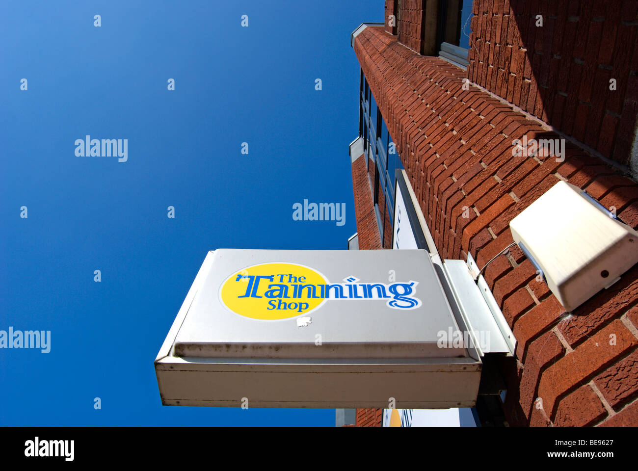sign for a branch of the tanning shop, in twickenham, middlesex, england Stock Photo