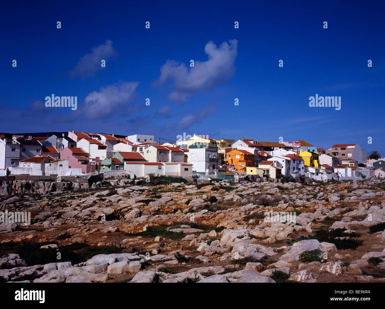 PORTUGAL Estremadura Ribatejo Peniche Atlantic Ocean town. View across rocky foreshore towards colourful painted - Stock Image