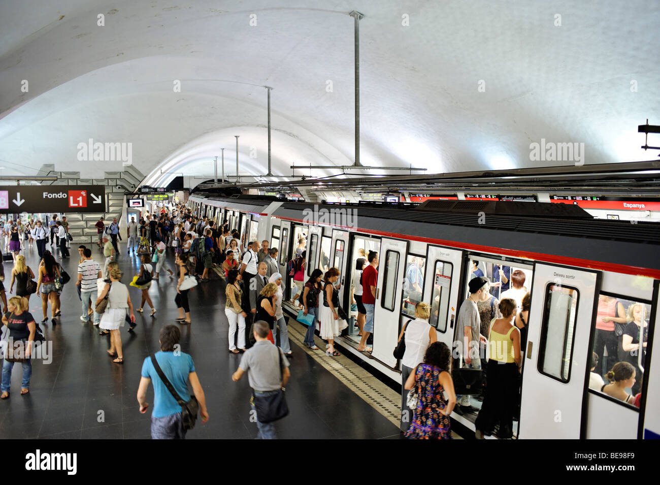 People boarding train at busy metro station. Barcelona. Spain - Stock Image