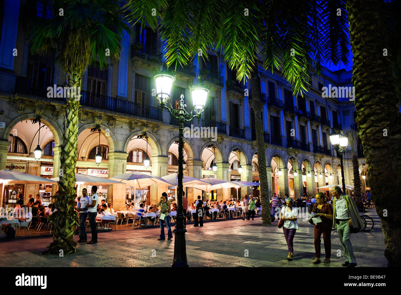 People dining alfresco on Plaza Reial. Barcelona. Spain - Stock Image