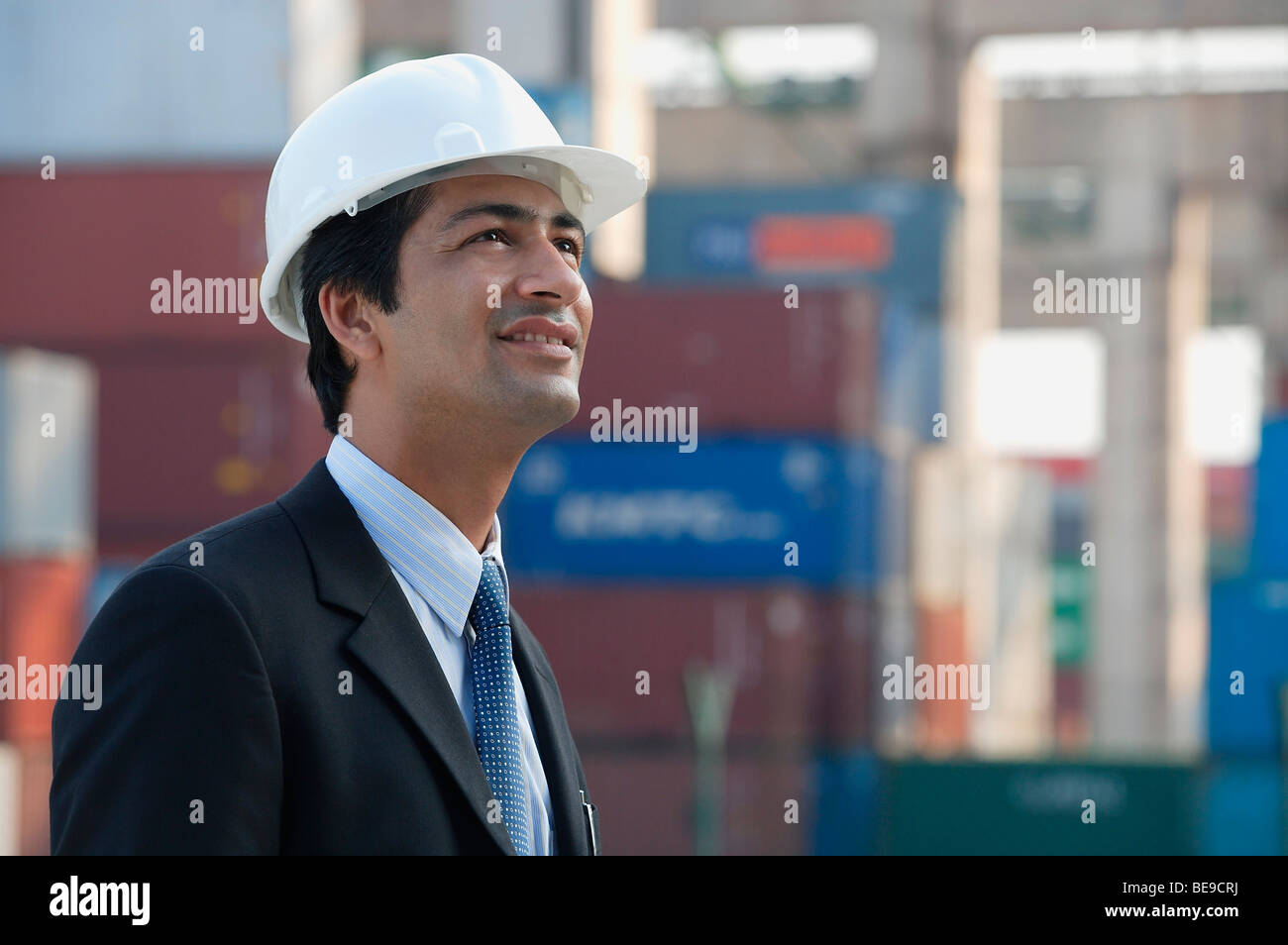 Man with helmet looking up - Stock Image