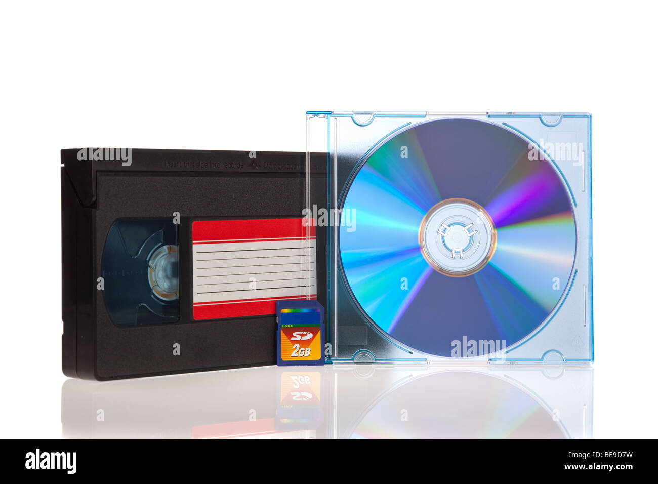 Old Video Cassette tape, with a DVD disc and Flash Memory Card isolated on white background - Stock Image