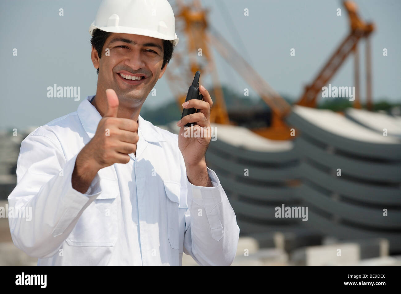 Man in work uniform gives thumb up - Stock Image