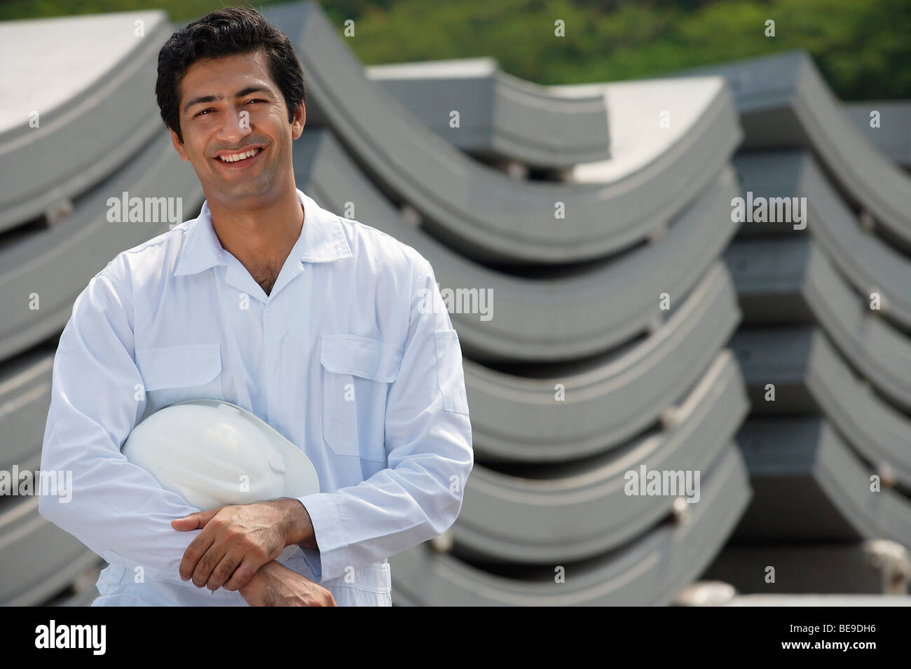Man in work uniform, smiling at camera - Stock Image