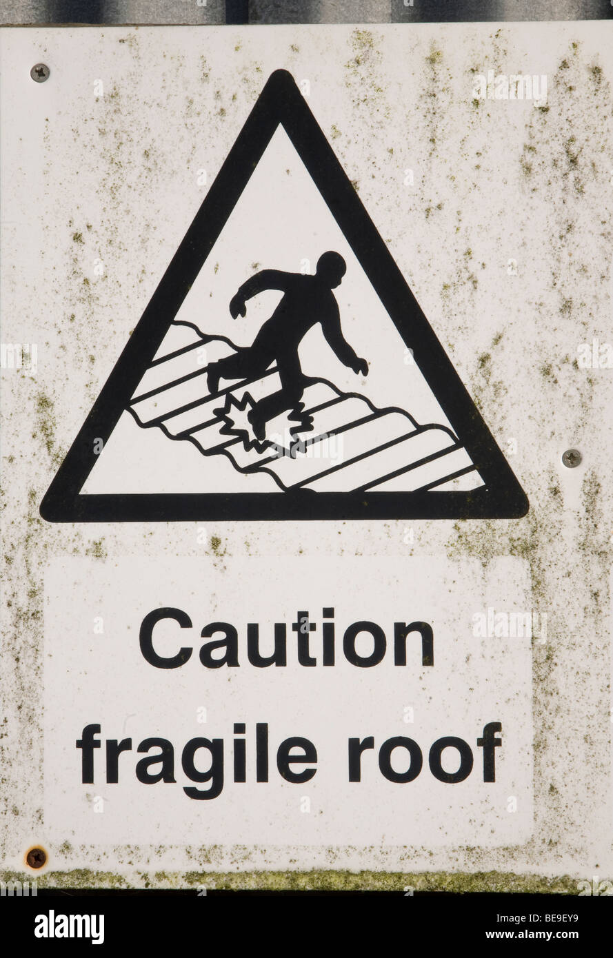 Sign Caution Fragile Roof - Stock Image