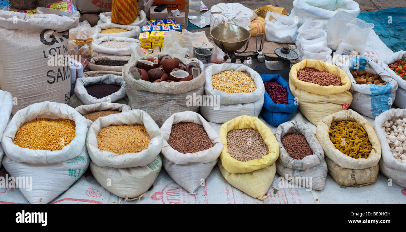 indian market stall with sacks of indian spices and dried produce - Stock Image