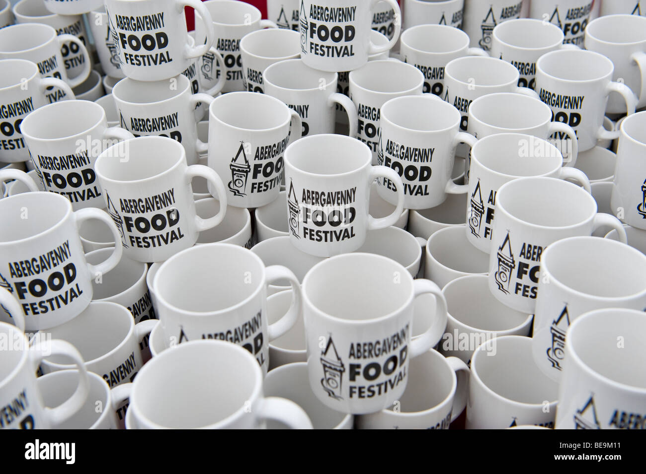 Promotional mugs for sale at Abergavenny Food Festival Monmouthshire South Wales UK - Stock Image