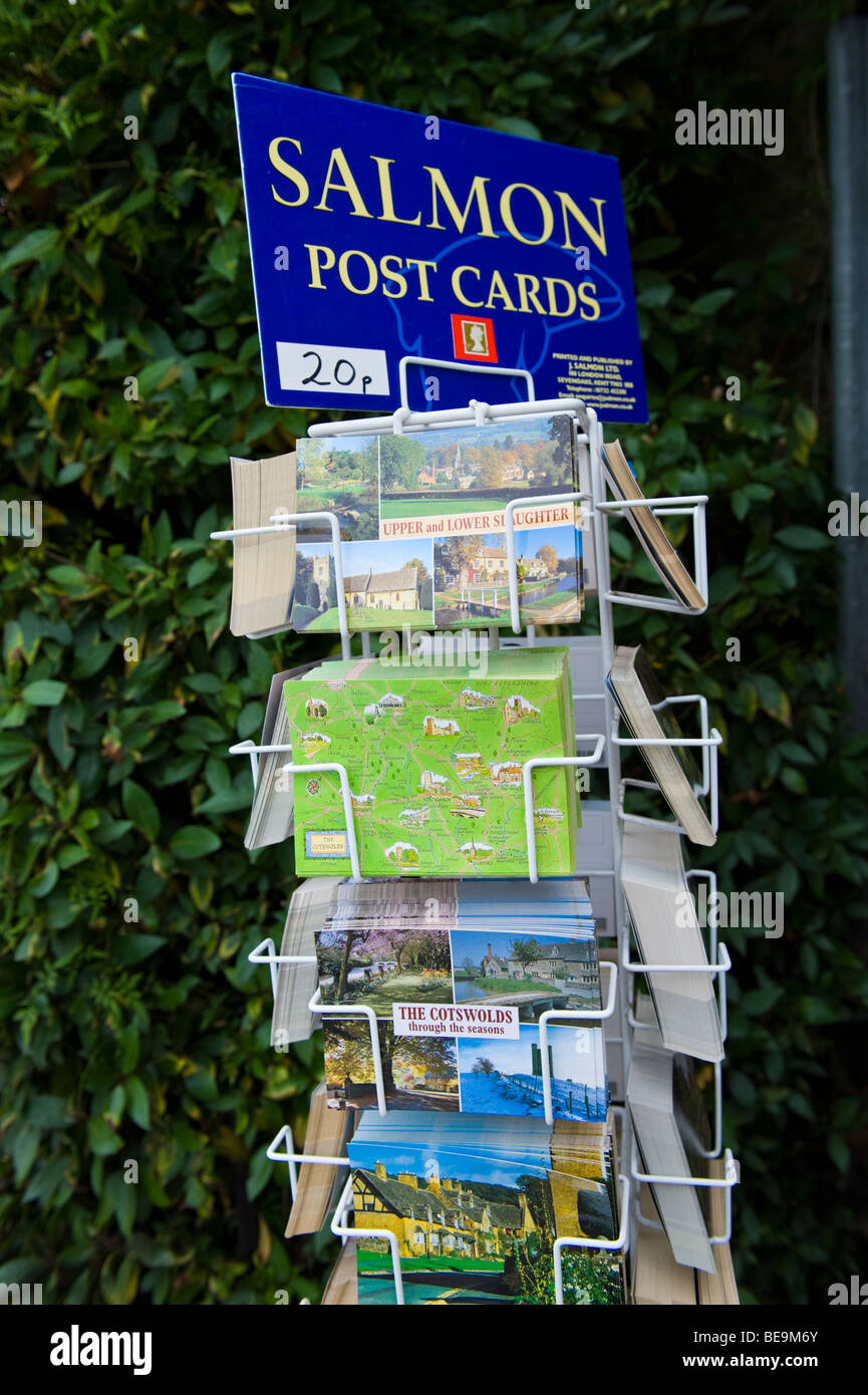 Salmon tourist postcards in rack for sale in Cotswold village of Bourton on the Water Gloucestershire England UK - Stock Image