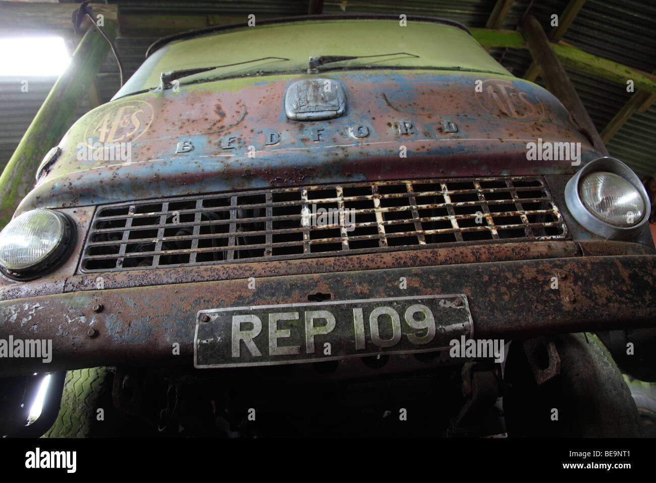 Bedford TK truck (circa 1960), in farmers barn - Stock Image