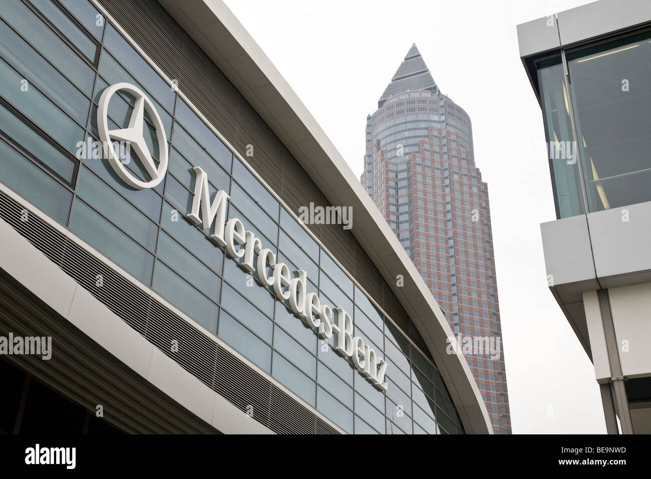 Motor Show Mercedes sign and Frankfurt Messe MesseTurm Trade Fair Tower in the Messegelande complex Stock Photo