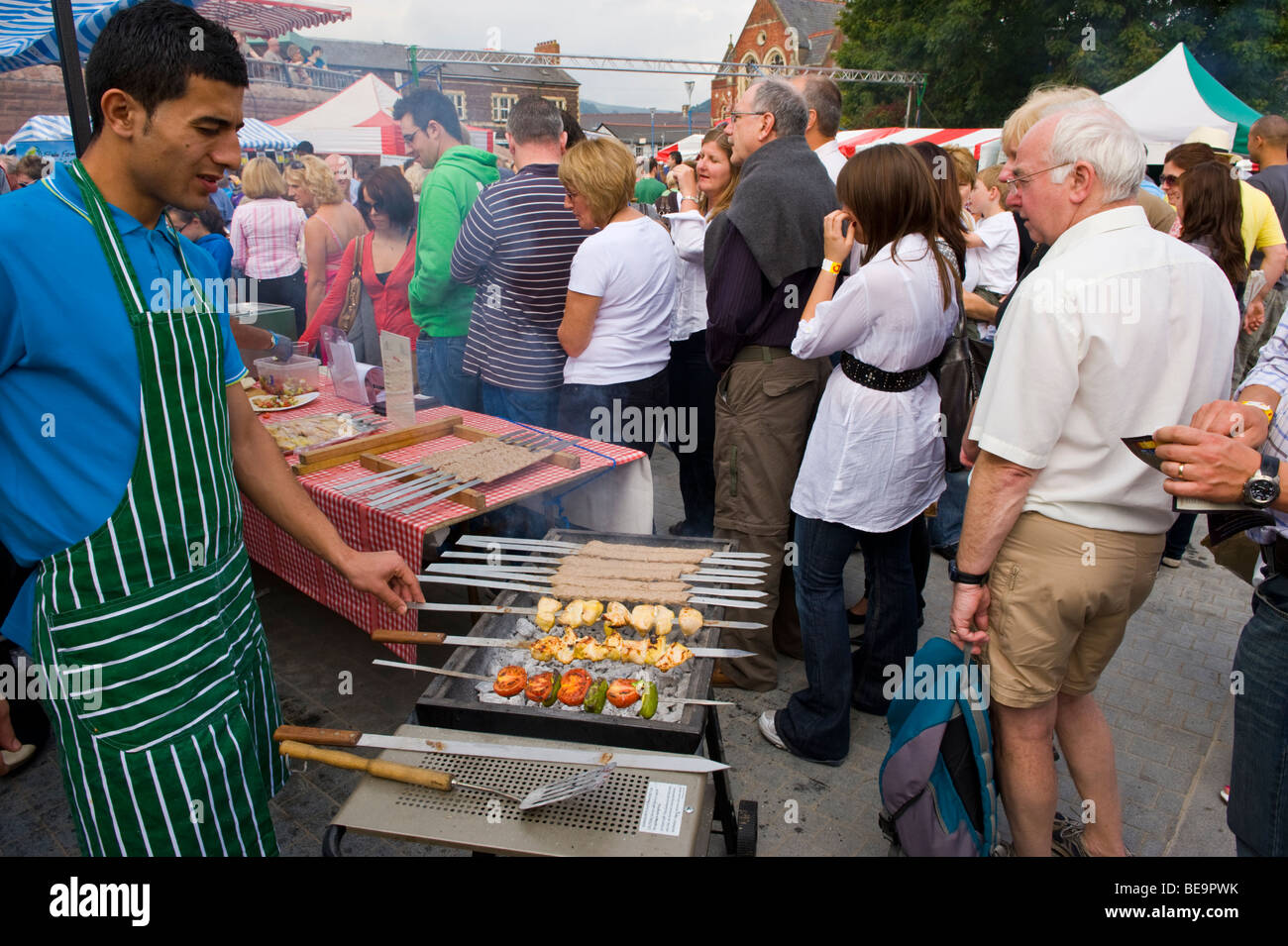 Kebabs being cooked on barbecue at Abergavenny Food Festival Monmouthshire South Wales UK - Stock Image