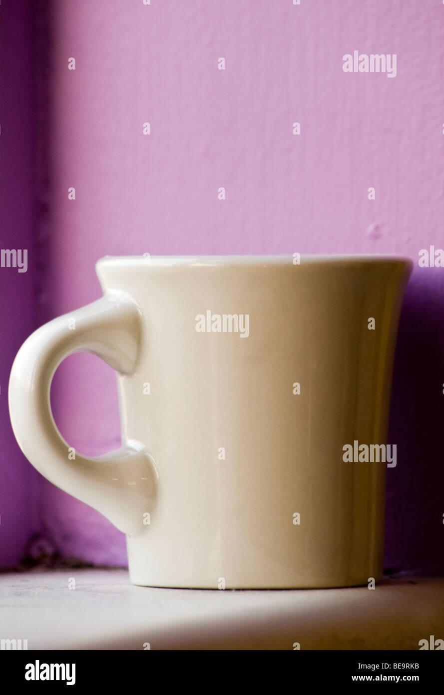 Close up detail of ceramic coffee mug - Stock Image