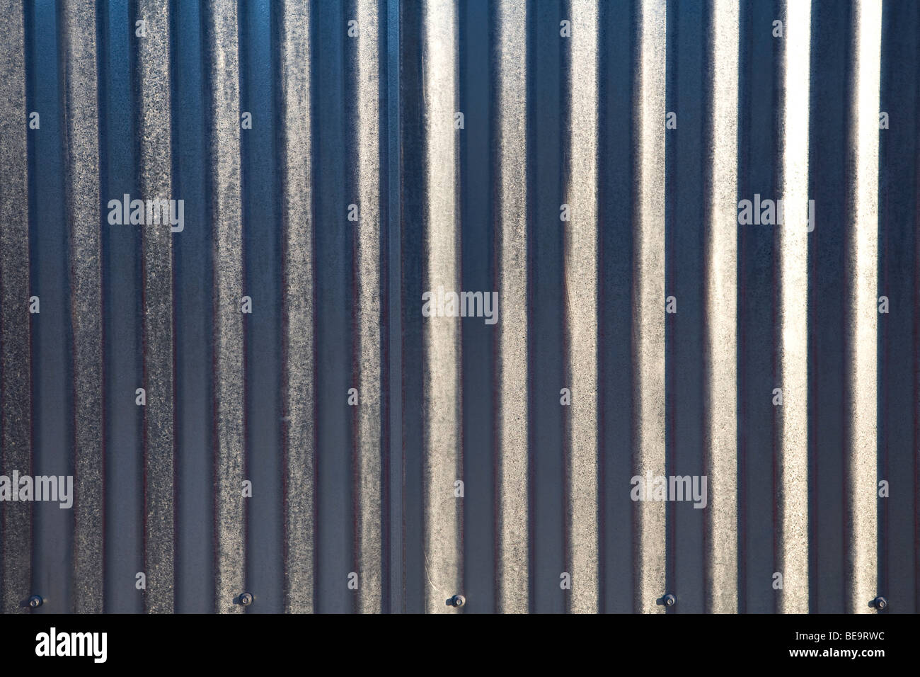 Close up of silver corrugated metal sheet - Stock Image