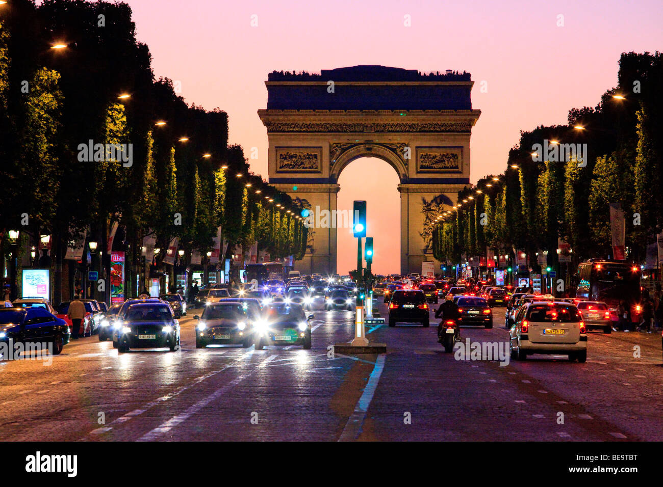 Arc de Triomphe and the Champs Elysees at night in Paris. - Stock Image