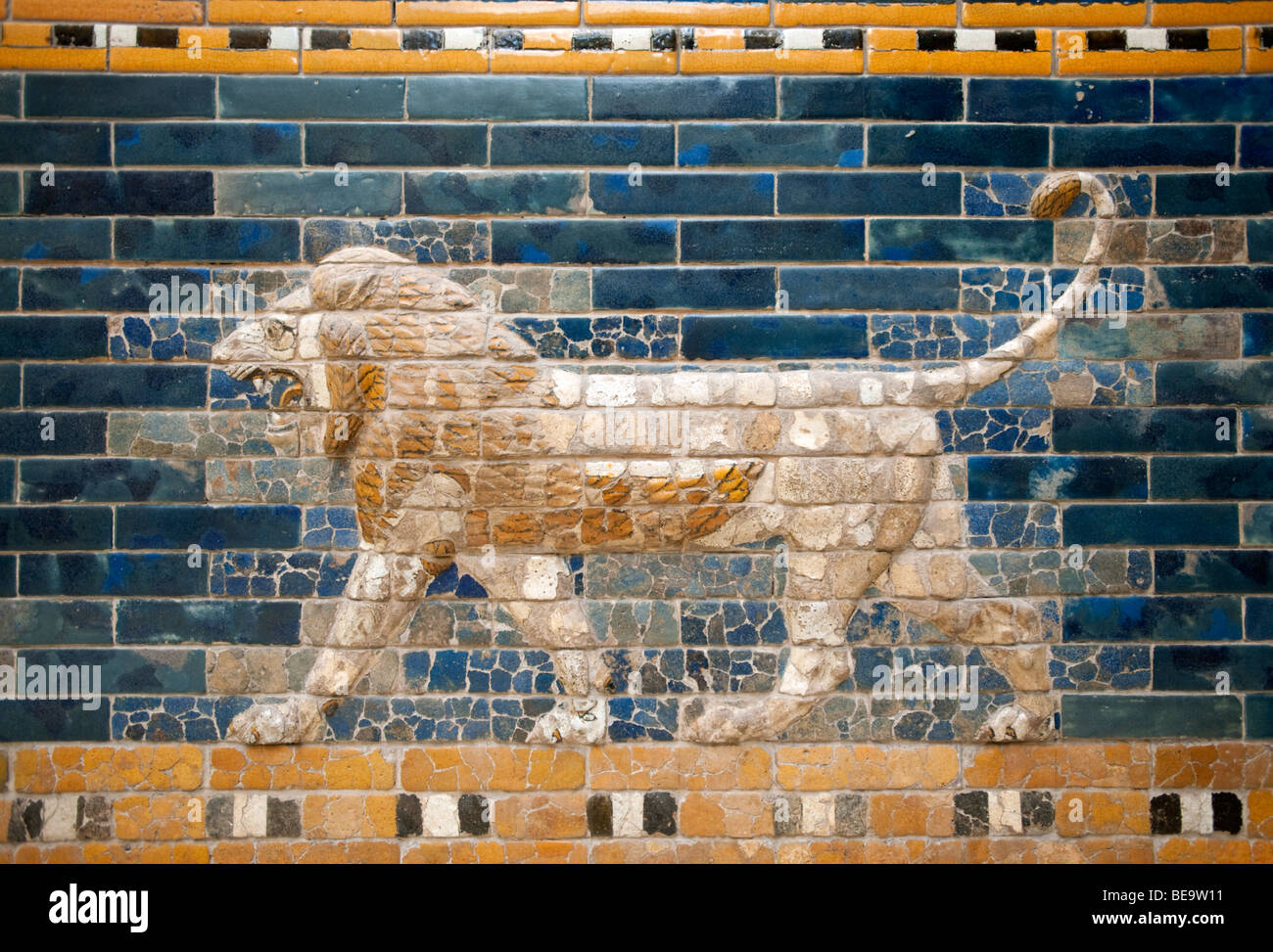 Lion mosaic on wall of Processional Way from Babylon in Pergamon Museum on Museumsinsel in Berlin Germany Stock Photo