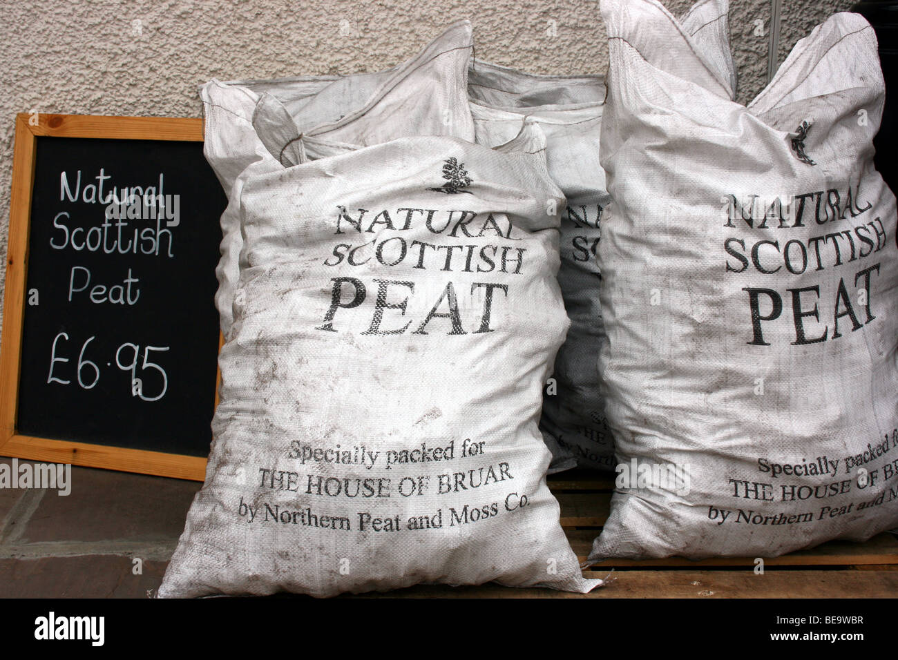 hessian sacks of Scottish peat, sold to be used as fuel, being sold at an outlet in Perthshire, Scotland - Stock Image