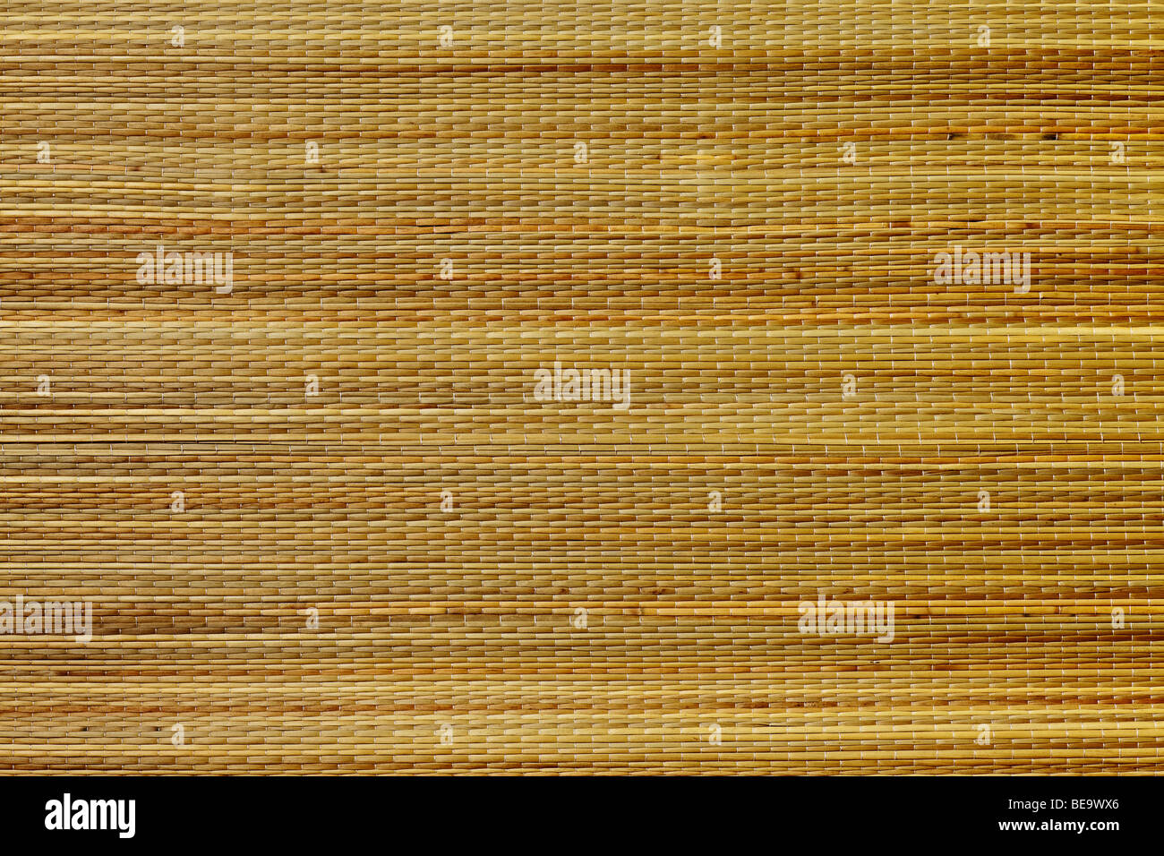 grass mat background in tan and brown tones - Stock Image