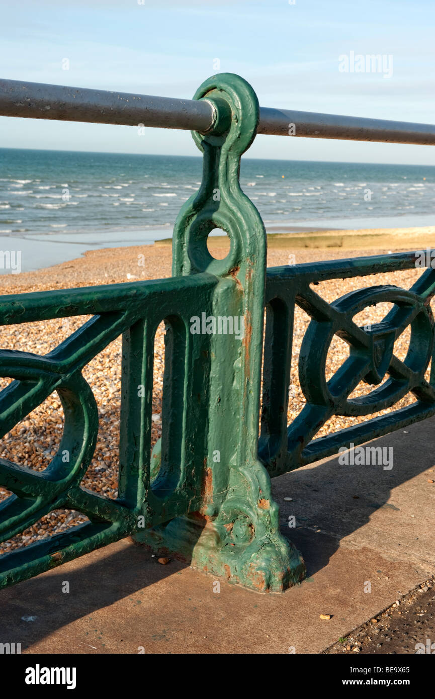 Green railing on the sea front - Stock Image