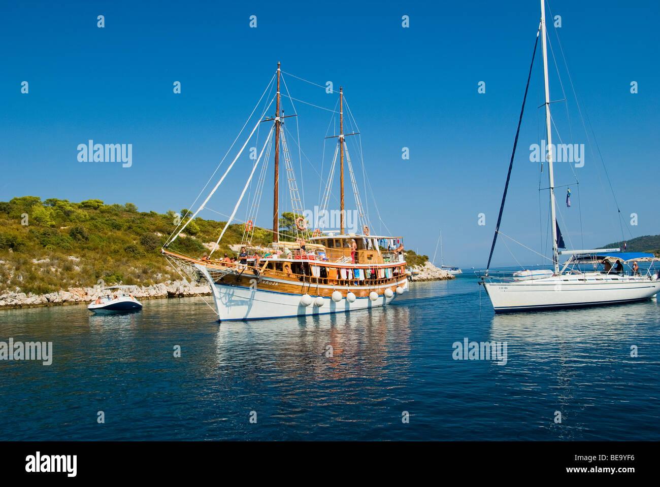 Croatia; Hrvartska; Kroatien, Vis, Croatian Gulet and sail charter boat anchored for lunch in beautiful Croatian Stock Photo