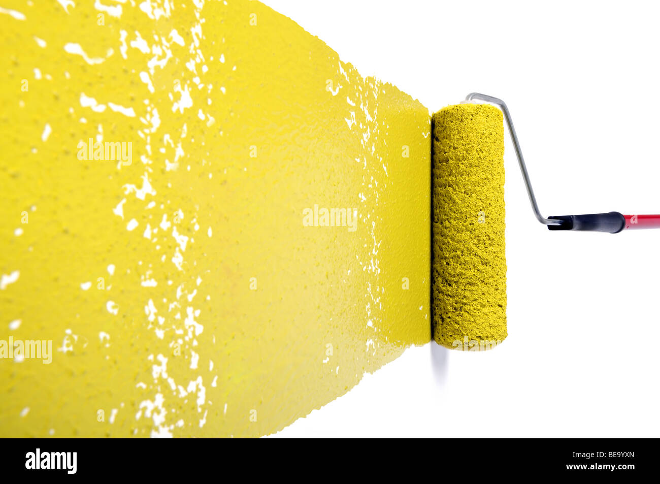 Pain roller with yellow paint on white wall Stock Photo: 26035037 ...