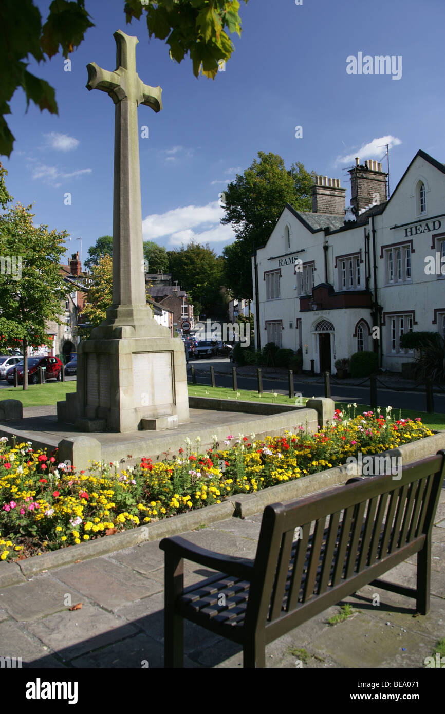 Village of Disley, England. Disley war memorial with the 19th century Rams Head public house in the background. Stock Photo