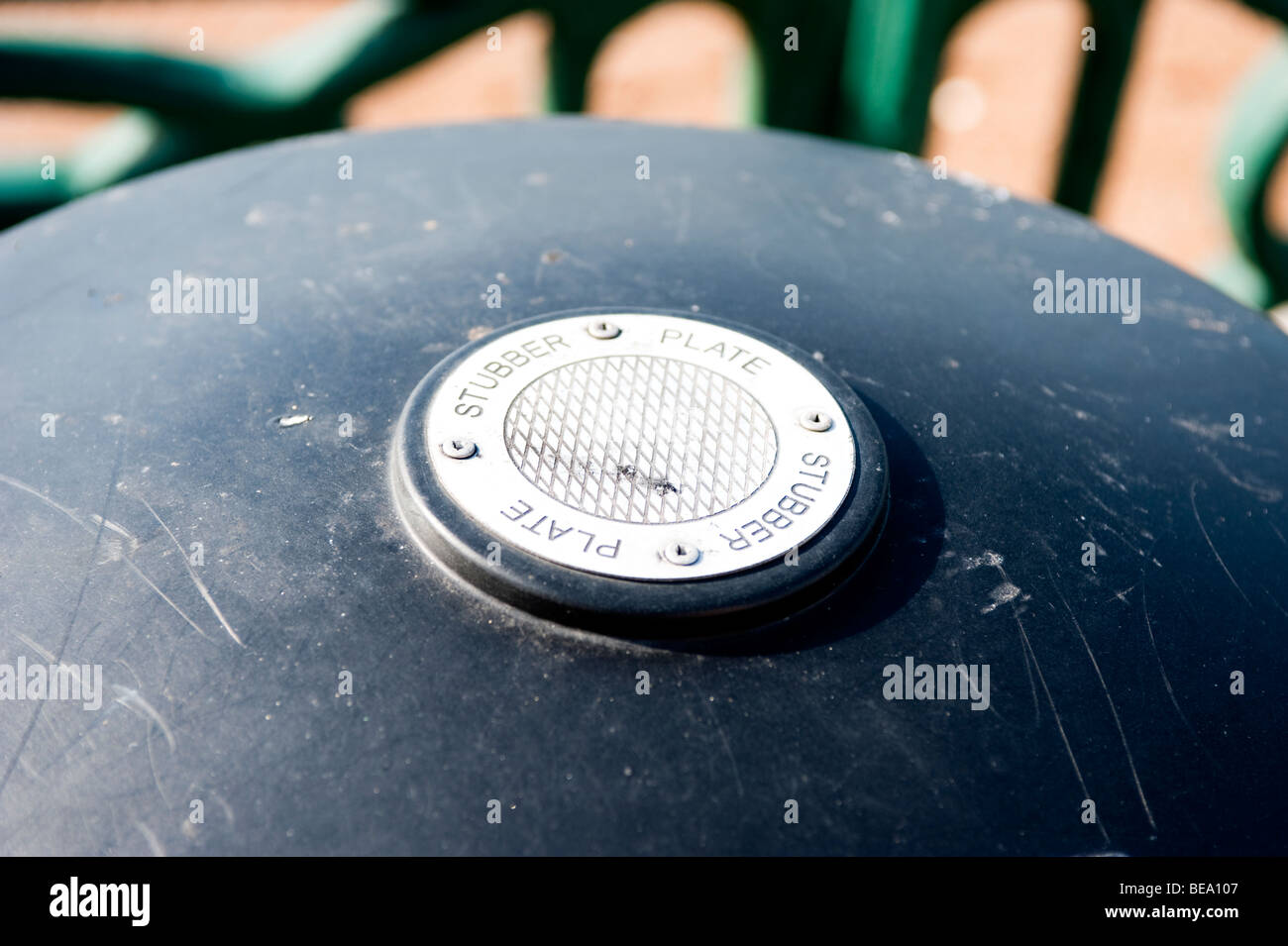 plate to stub out cigarettes on litter bin - Stock Image