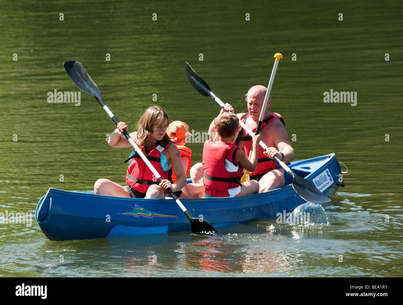 A family paddling a canoe on the River Lot, Aquitaine France - Stock Image