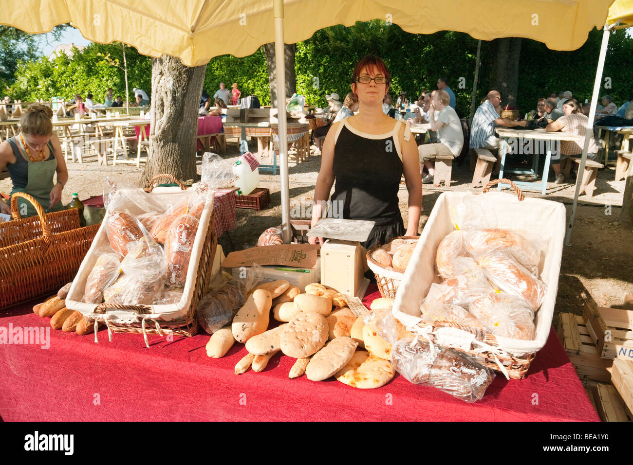 Bread stall at a French evening market, Laparade, Aquitaine, France - Stock Image