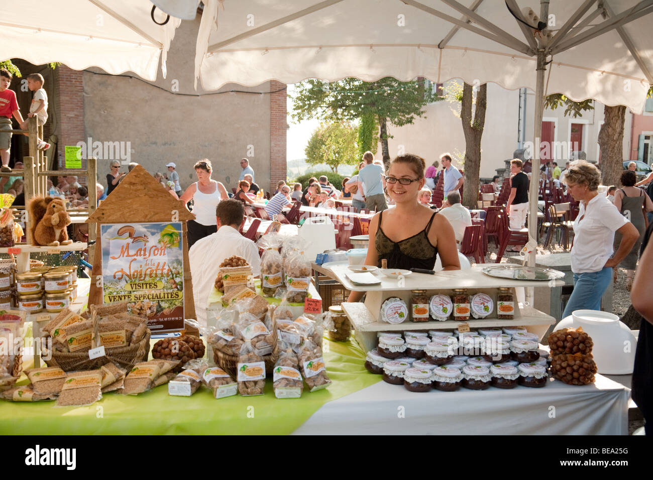 Stallkeeper at the evening farmers market in the village of Laparade, Lot et Garonne, Aquitaine, France - Stock Image