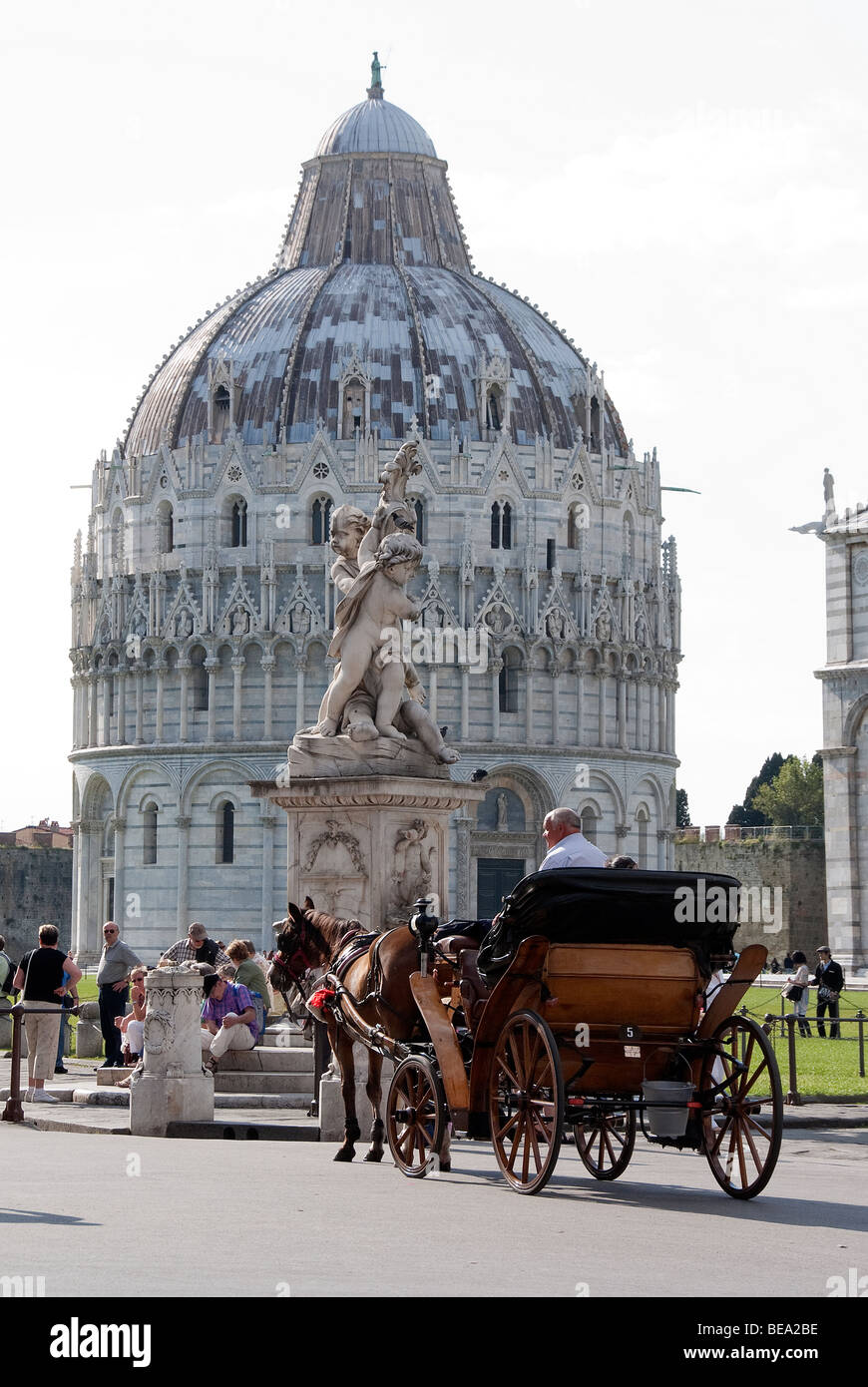 A horse and carriage outside the Baptistery near the Leaning Tower - Stock Image