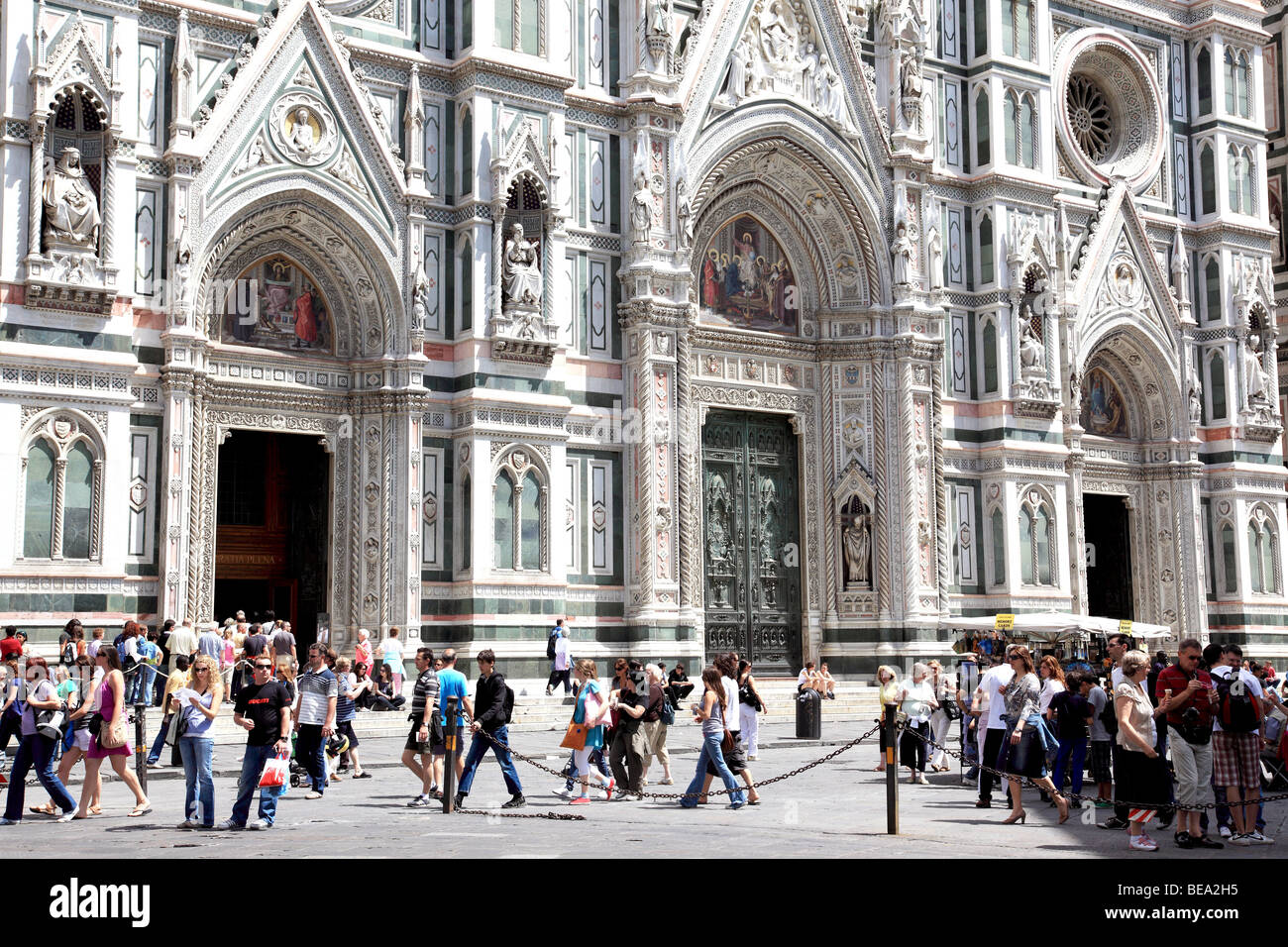 Visitors outside the Duomo in Florence Italy - Stock Image