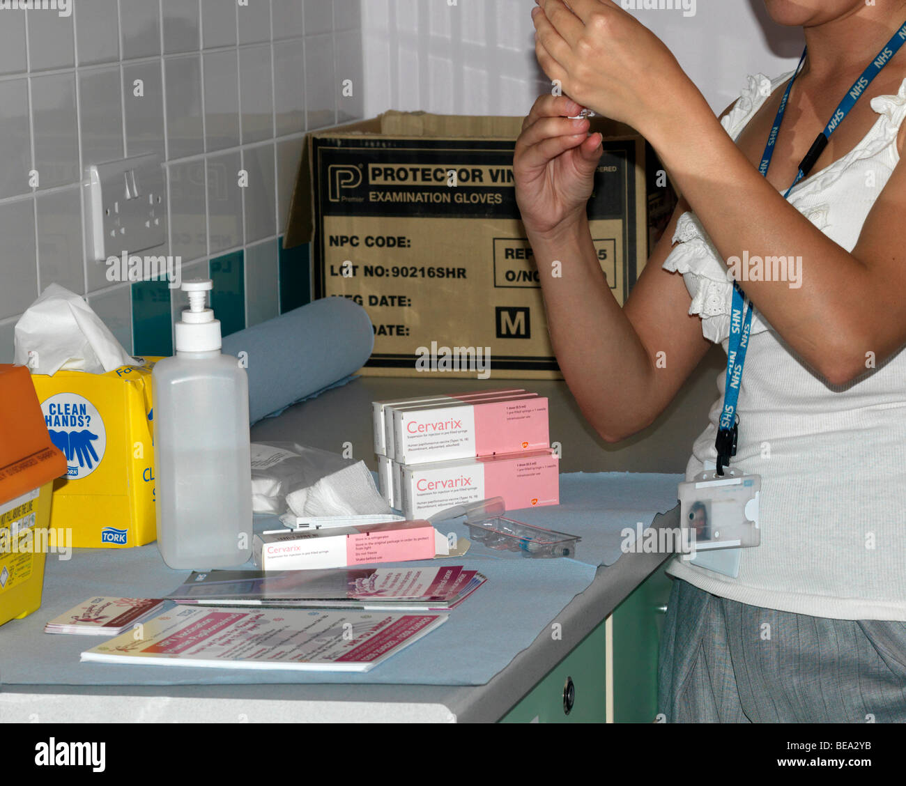 Nurse preparing a HPV injection to protect against Cervical Cancer Stock Photo